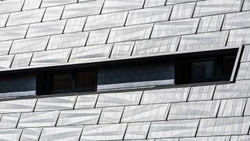 Rivestimenti esterni effetto 'pietra' per una villa in Alto Adige