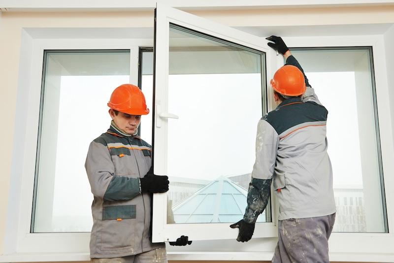 two workers installing window