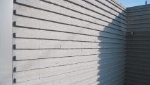 Progettare un muro divisorio per un giardino: un esempio realizzato